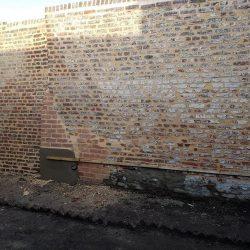 Réparation d'un mur à Arras